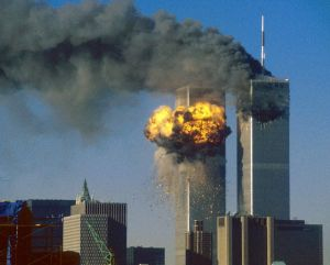 The World Trade Center south tower (L) bursts into flames after being struck by hijacked United Airlines Flight 175 as the north tower burns following an earlier attack by a hijacked airliner in New York City in this September 11, 2001 file photo. REUTERS/Sean Adair/Files (UNITED STATES DISASTER POLITICS)